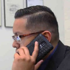man on phone in office conducting business over the phone